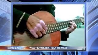 бомж играет на гитаре тему из Бандитского Петербурга