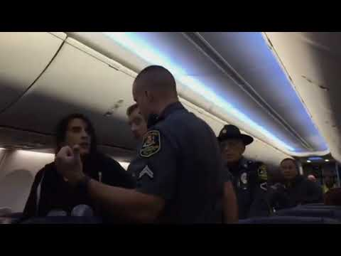 Girl Dragged off Plane for Overbooked Flight!!