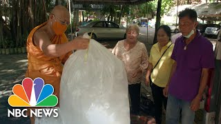 Monks Turn Plastic Waste Into Masks To Stop Spread Of COVID-19 | NBC News
