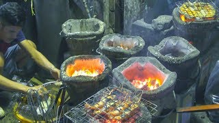 Bangkok Street Food. Seafood and Fish on Fire in Sukhumvit Soi 1,Thailand