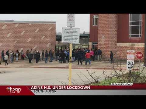 Parents wait for their students following lockdown