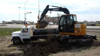 John Deere 75D Excavator Loading Clay into Single Axle