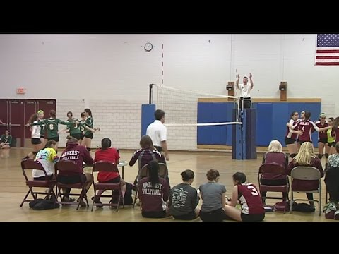 Amherst high school varsity volleyball team kneeled for National Anthem