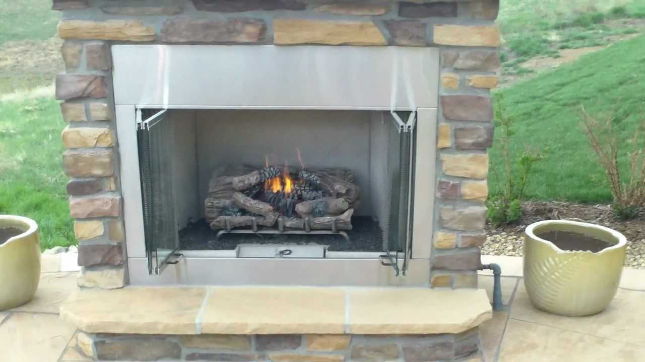 outdoor gas fireplace with buff flagstone patio installed by