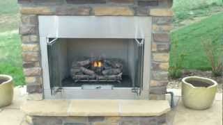 Outdoor Gas Fireplace With Buff Flagstone Patio Installed By Denver Landscape Contractor