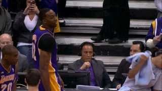Dwight Howard grabs a towel from towel girl and throws it at her lol