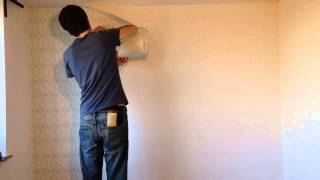 Hanging 'paste the wall' wallpaper