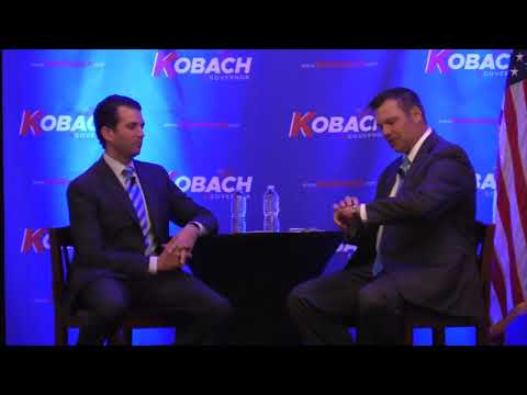 Donald Trump Jr. talks with Kris Kobach on Tuesday, Nov. 28, 2017 in Overland Park