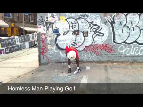 Homeless man playing golf in Soho