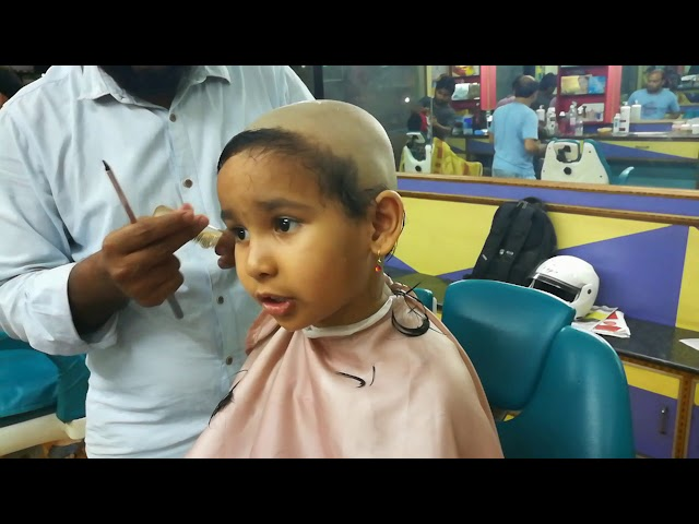 Shaving Pari's head at 4 year age