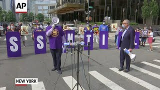 Protesters call for essential worker hazard pay