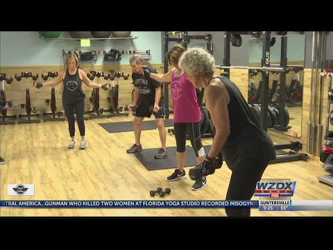70 year old fitness trainer inspiring older adults to get healthy