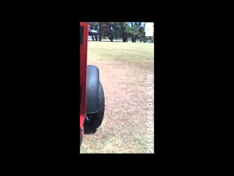 NV Enclosed mobility scooter powering up a 40 degree grass bank