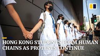 Hong Kong students form human chains as protests continue