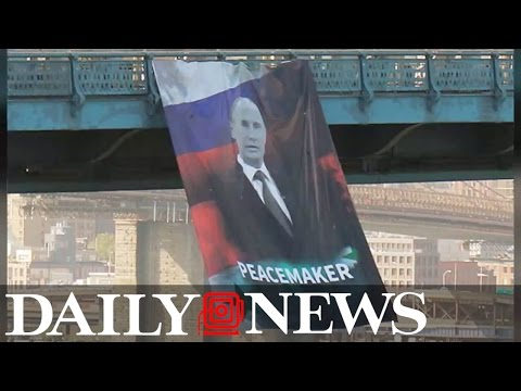Banner of Russian President Vladimir Putin appears on Manhattan Bridge