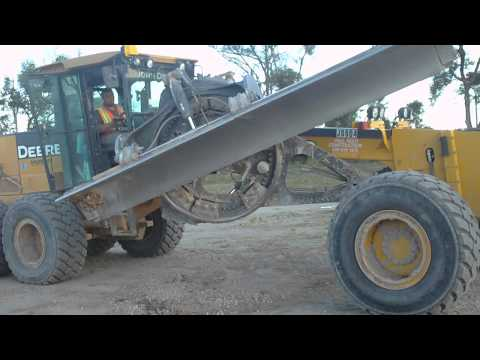 swinging the saddle out on a motor grader