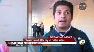 Shoppers watch little boy set clothes on fire