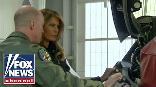 Melania Trump tours military bases, Navy aircraft carrier