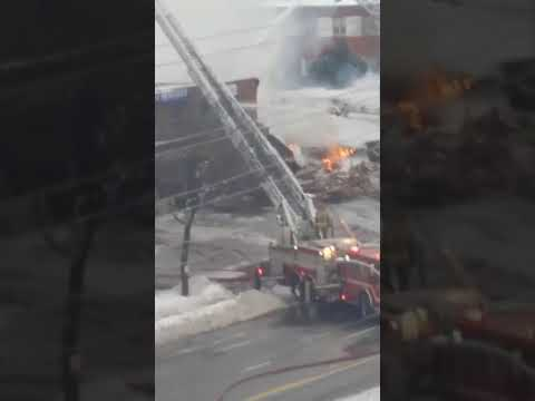 Mississauga firefighters extinguish flaming pile of rubble after explosion at Mississauga strip mall