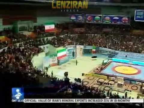 Ahmadinejad under American flag and United States media in Tehran
