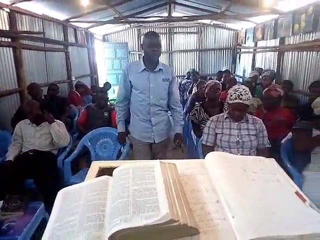 Brother Joseph Teaching the Ezra 4:13-21 & Rev 5:1-5 WFF/GMFC Kibera Slum Church