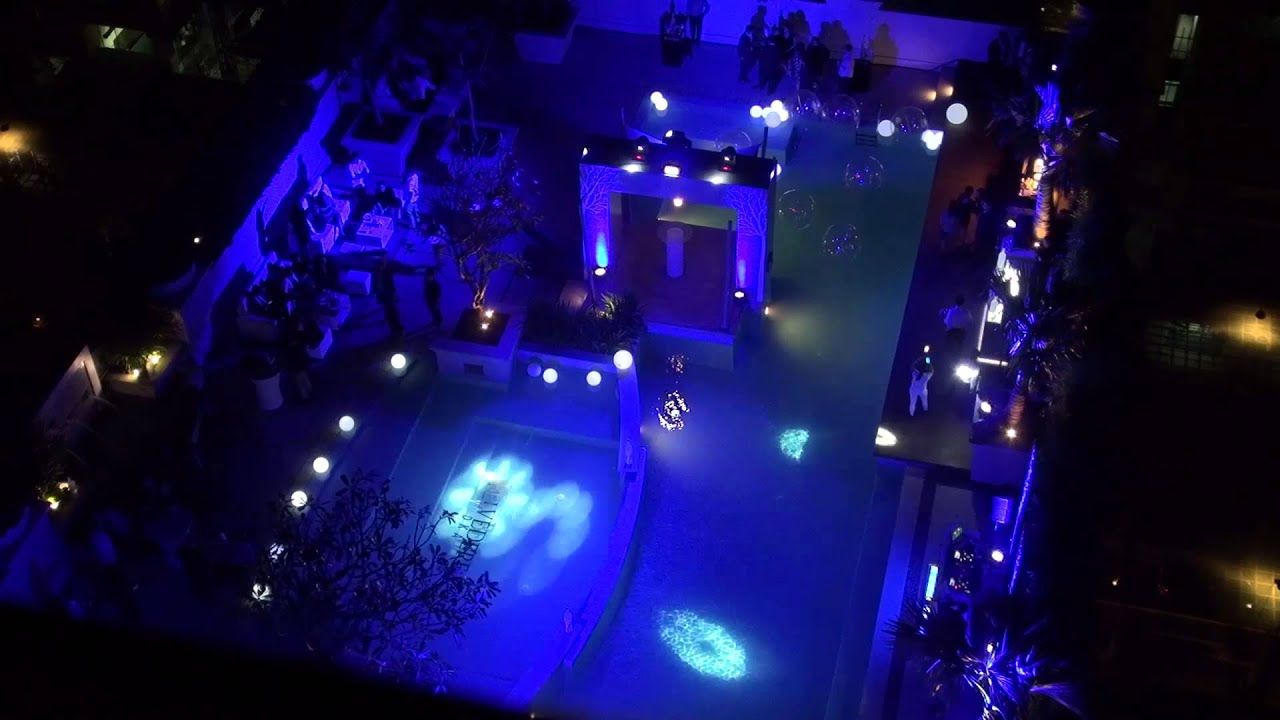 Raffles makati spectacular light show pool party youtube for Pool light show waikiki