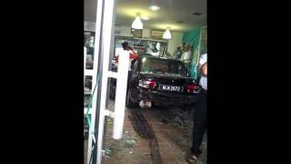 women in panic,car crashes into superbike store3