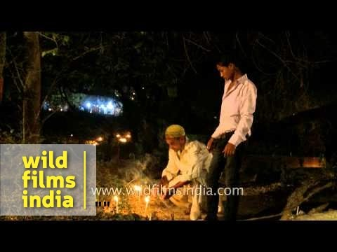 Muslim devotee lighting candle during Shab-e-barat - Delhi