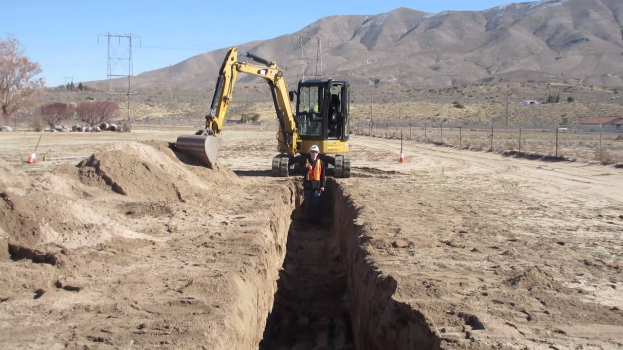 Digging A Trench With CAT Excavator By Operator Deshazo