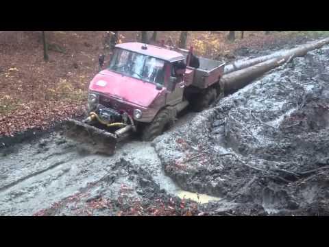 Mercedes Unimog pull heavy logs