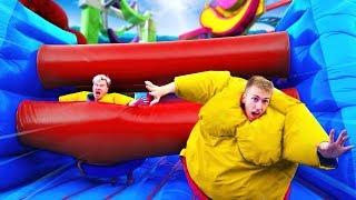 We ATTEMPTED an OBSTACLE Course in SUMO Suits...