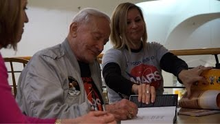 Fans Prepare Their One Question for Buzz Aldrin at the Book Revue