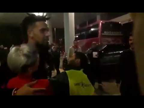 Olympiacos fans cheering for Daniel Hackett on his way out of the gym