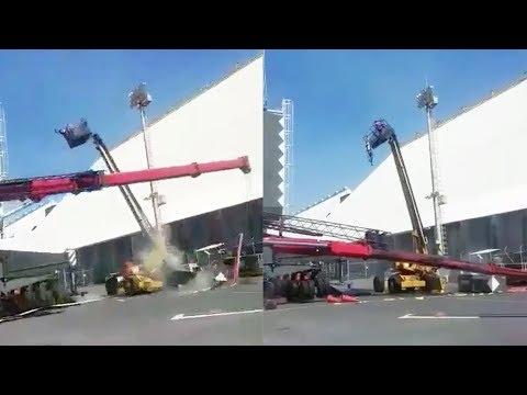 Man Left Hanging After Crane Falls Over 😮