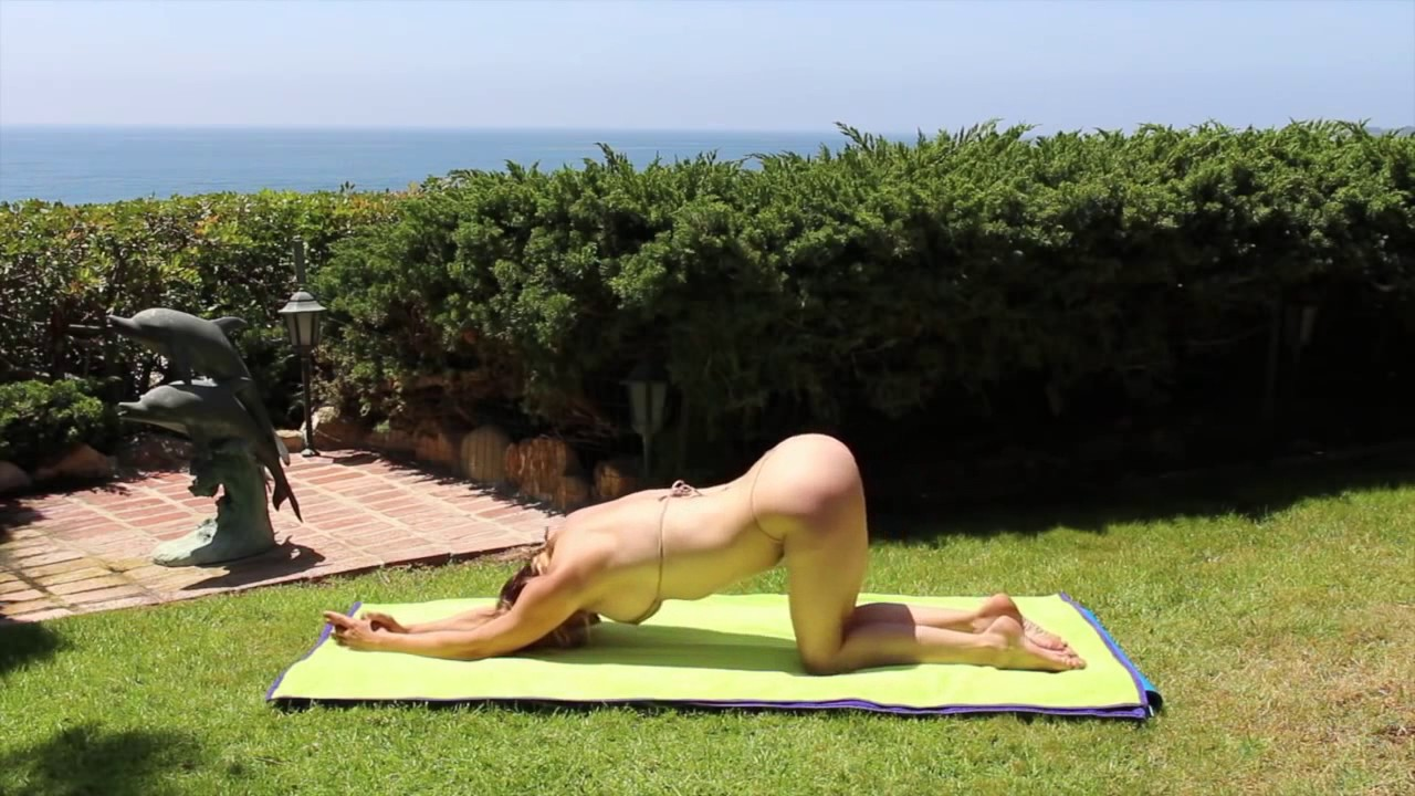 Stretched out nude girl on back