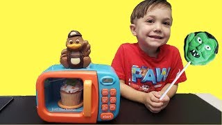 Zack playing with Just Like Home Magic Toy Microwave Oven Play Kitchen Set for kids!