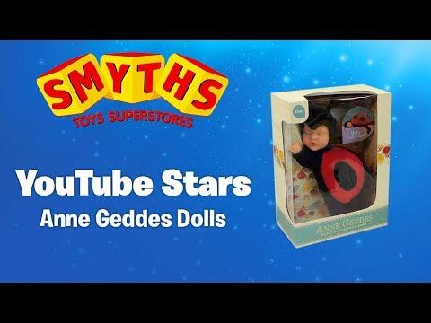 Aisha Playing With Anne Geddes Dolls