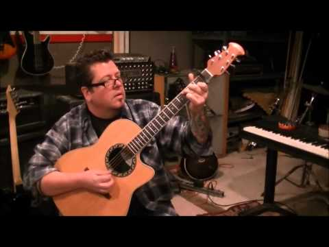 How to play Three Wooden Crosses by Randy Travis on guitar by Mike Gross
