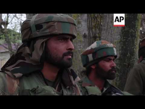 India police in firefight with Kashmir rebels, protest