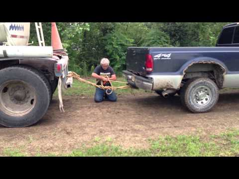 Ford F250 4x4 diesel Truck pulling a Semitruck out of mud. part 2