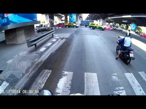 Riding a scooter to work, Bangkok