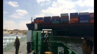 ships crossing the canal to stop infectious tiger 6 and stacked cars