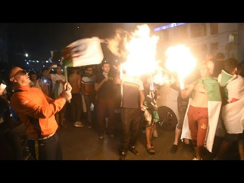 Algerians celebrate team's win at the Algiers' Post Office   AFP