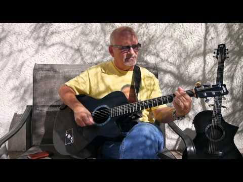 Acoustic Bruce  of Watching The Wheels  John Lenn