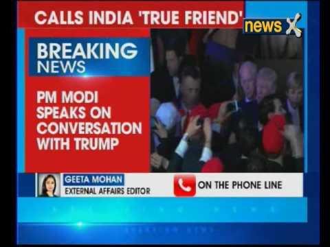 US President Donald Trump speaks with Prime Minister Narendra Modi