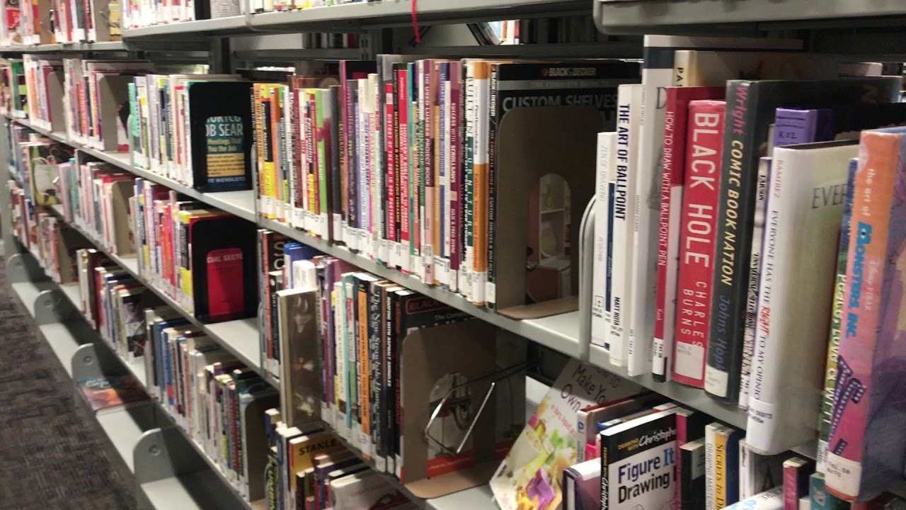 Panning Shot Of Books On Shelf In Empty Library - Free Stock Footage