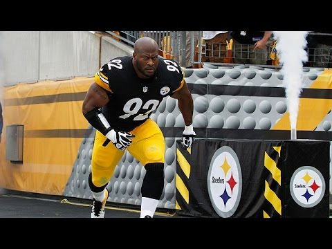 James Harrison does push-ups with Maurkice Pouncey on his back