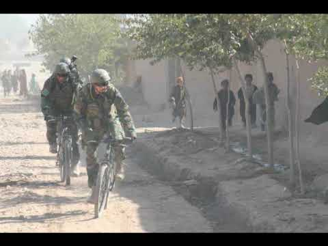 Dutch Royal Marine Light Bicycle Infantry backed by AIFV M113 Gavins in Afghanistan