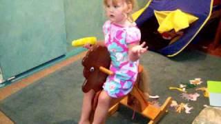 Scarlett On Rocking Horse