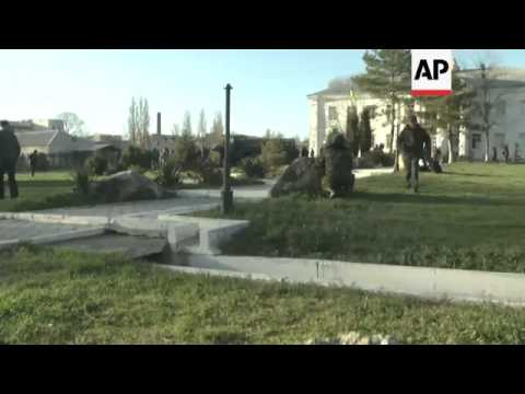 Pro-Russian forces stormed a Ukrainian air force base in Crimea, firing shots and stun grenades and